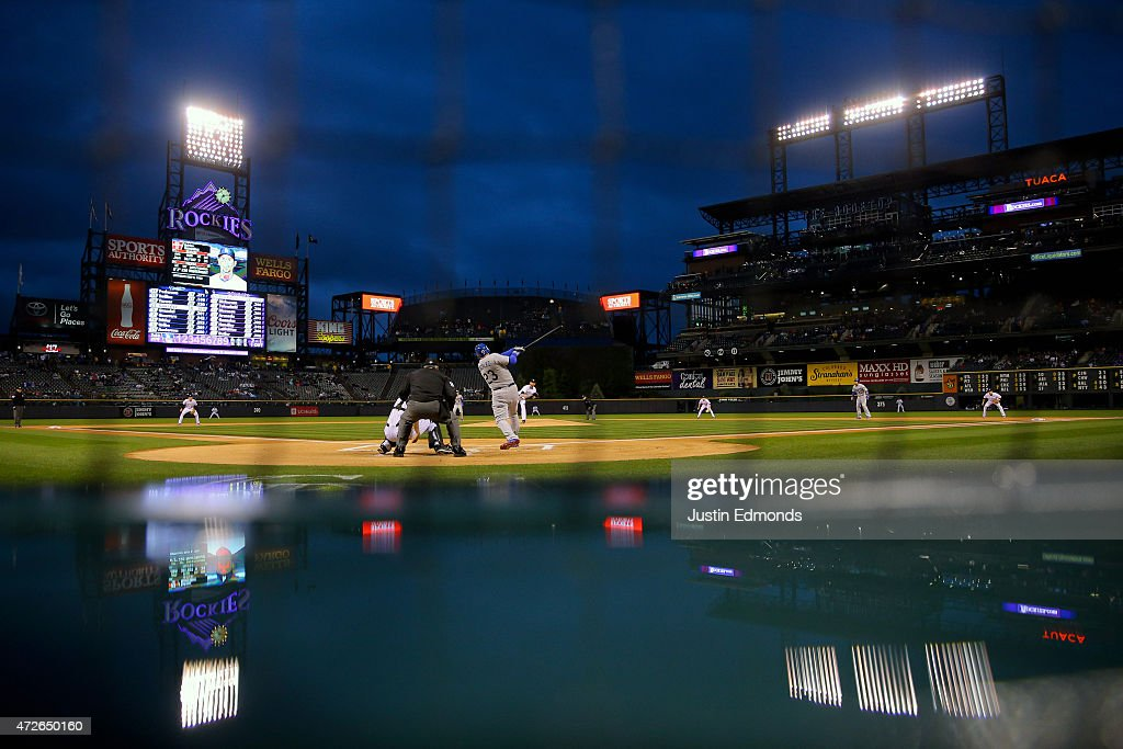 Adrian Gonzalez #23 of the Los Angeles Dodgers hits a ground rule RBI double during the first inning against Starting pitcher Eddie Butler #31 of the Colorado Rockies at Coors Field on May 8, 2015 in Denver, Colorado.