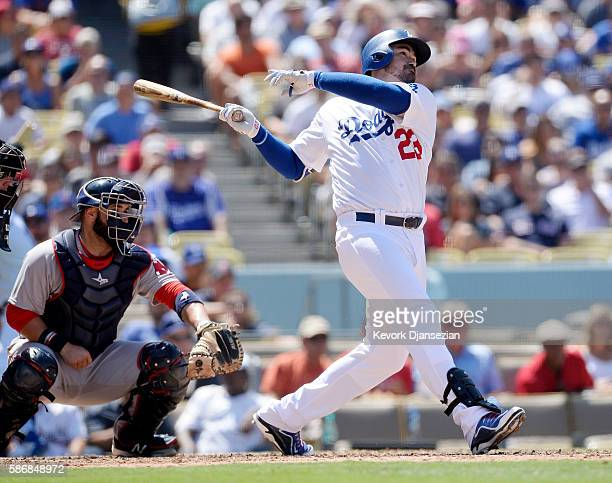 Adrian Gonzalez of the Los Angeles Dodgers hits a one run base hit during the fifth inning of the baseball game at Dodger Stadium Stadium August 6 in...