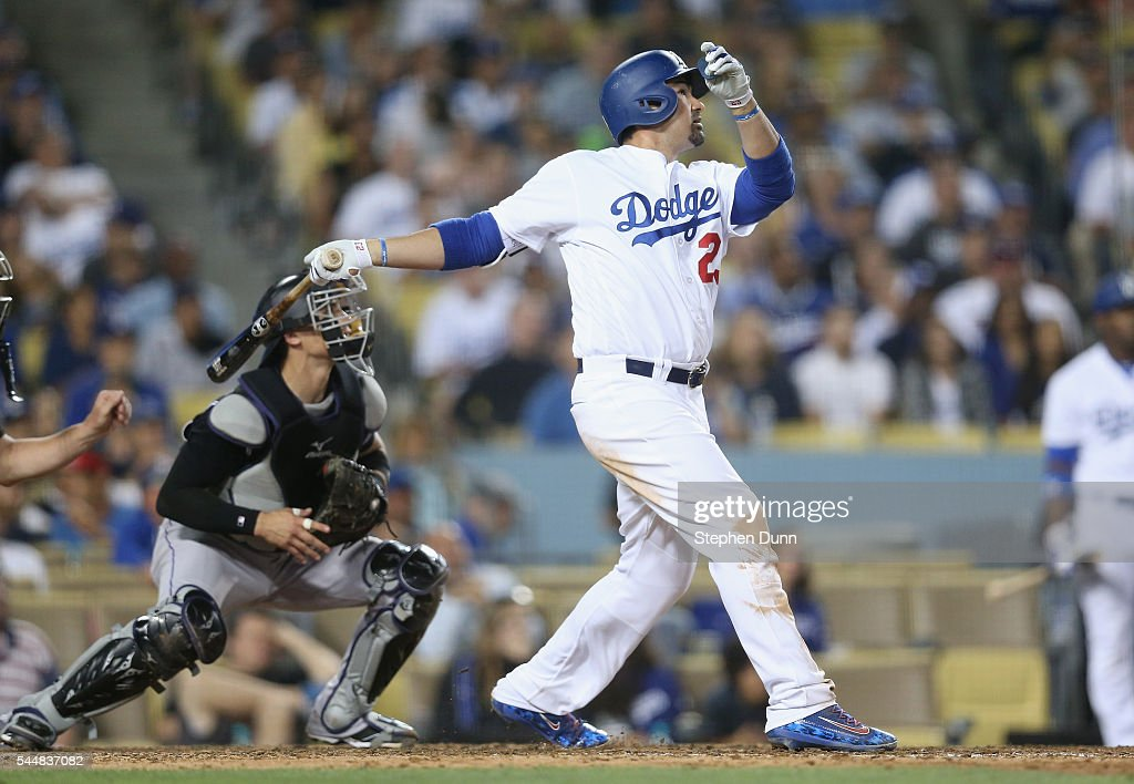 Adrian Gonzalez #23 of the Los Angeles Dodgers hits a sacrifice fly to bring in Howie Kendrick in the seventh inning against the Colorado Rockies at Dodger Stadium on July 2, 2016 in Los Angeles, California.