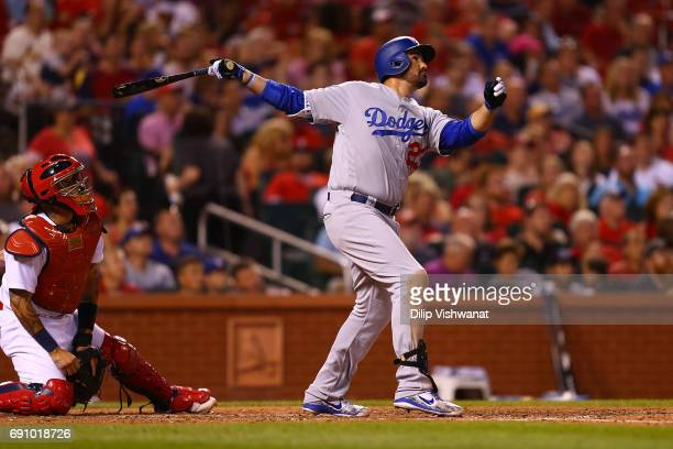 Adrian Gonzalez of the Los Angeles Dodgers hits a sacrifice for an RBI against the St Louis Cardinals in the sixth inning at Busch Stadium on May 31...