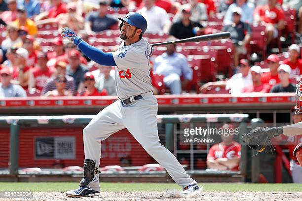 Adrian Gonzalez of the Los Angeles Dodgers hits a solo home run in the fifth inning against the Cincinnati Reds at Great American Ball Park on August...