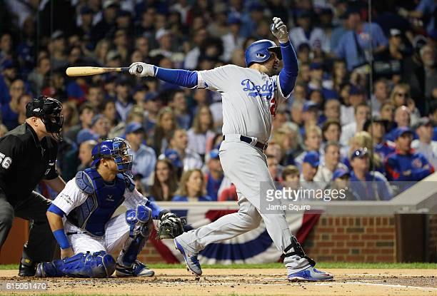 Adrian Gonzalez of the Los Angeles Dodgers hits a solo home run in the second inning against the Chicago Cubs during game two of the National League...