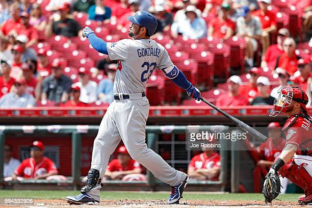 Adrian Gonzalez of the Los Angeles Dodgers hits a threerun home run against the Cincinnati Reds in the first inning at Great American Ball Park on...