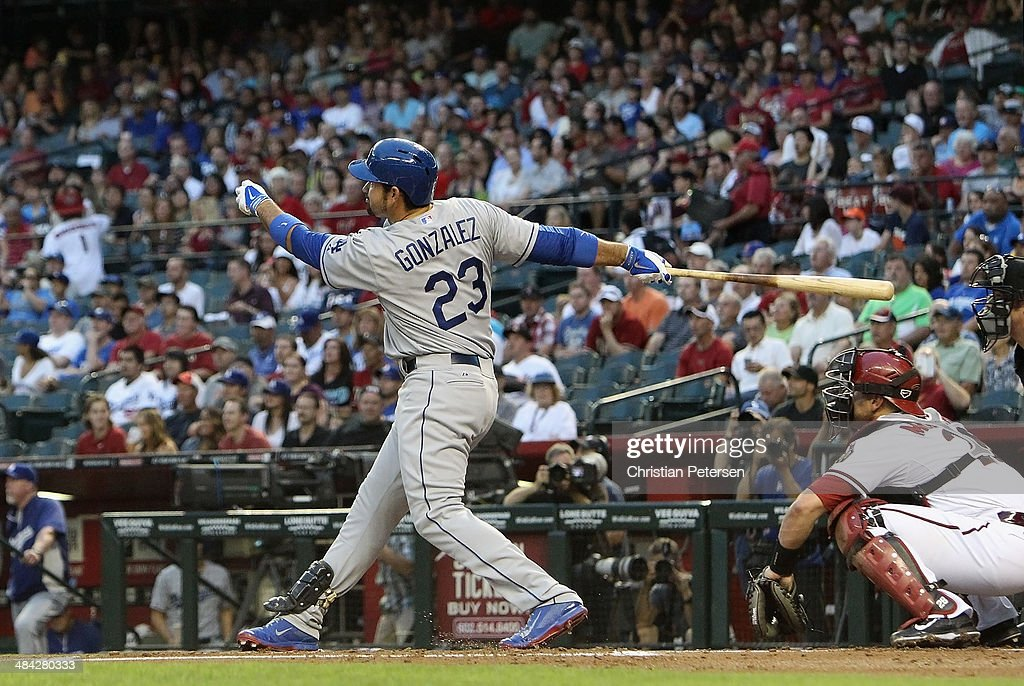 Adrian Gonzalez #23 of the Los Angeles Dodgers hits a two-run home run against the Arizona Diamondbacks during the first inning of the MLB game at Chase Field on April 11, 2014 in Phoenix, Arizona. The Dodgers defeated the Diamondbacks 6-0.