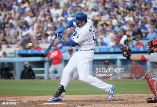 Adrian Gonzalez of the Los Angeles Dodgers hits an sacrifice fly to bring the Dodgers' second run of the first inning against the Cincinnati Reds at...