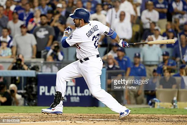 Adrian Gonzalez of the Los Angeles Dodgers hits the ball to score Howie Kendrick in the fourth inning against the Chicago Cubs in game five of the...