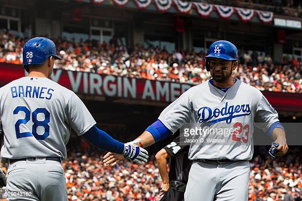Adrian Gonzalez of the Los Angeles Dodgers is congratulated by Austin Barnes after scoring a run against the San Francisco Giants during the second...