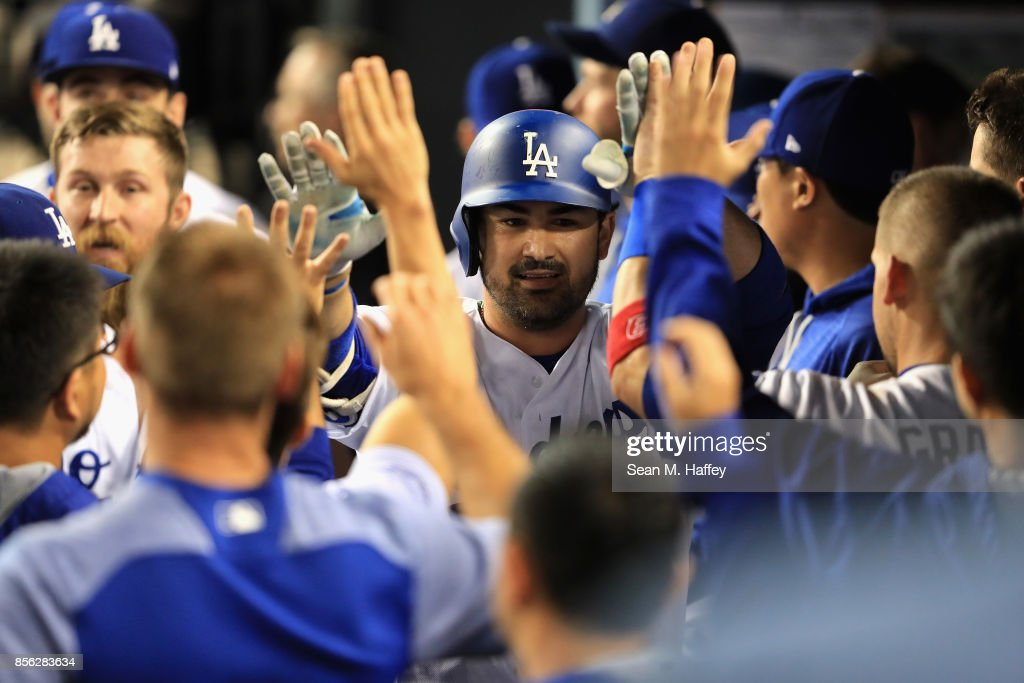 Adrian Gonzalez #23 of the Los Angeles Dodgers is congratulated in the dugout during a game against the San Diego Padres at Dodger Stadium on September 26, 2017 in Los Angeles, California.