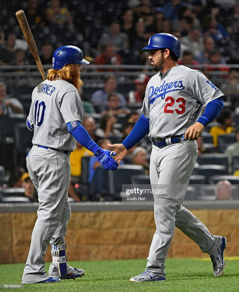 Adrian Gonzalez #23 of the Los Angeles Dodgers is greeted by Justin Turner #10 after coming around to score on a RBI single by Corey Seager #5 in the sixth inning during the game against the Pittsburgh Pirates at PNC Park on August 22, 2017 in Pittsburgh, Pennsylvania.