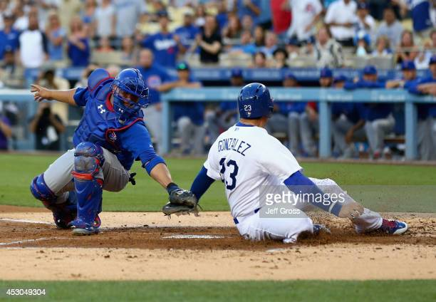 Adrian Gonzalez of the Los Angeles Dodgers is tagged out by catcher Welington Castillo of the Chicago Cubs in the first inning at Dodger Stadium on...