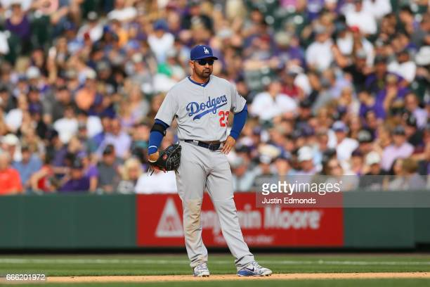 Adrian Gonzalez of the Los Angeles Dodgers looks on from first base against the Colorado Rockies on Opening Day at Coors Field on April 7 2017 in...