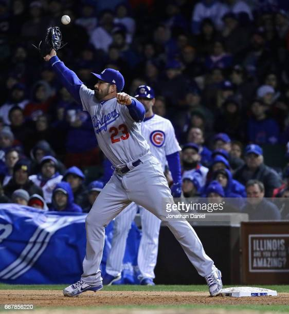 Adrian Gonzalez of the Los Angeles Dodgers misses the throw for an error in the 8th inning against the Chicago Cubs at Wrigley Field on April 12 2017...