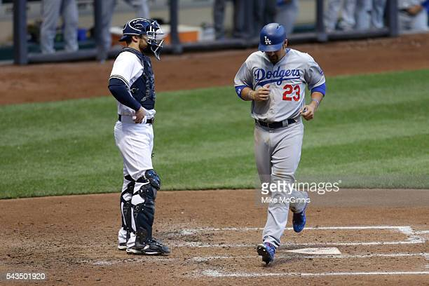 Adrian Gonzalez of the Los Angeles Dodgers reaches on a RBI single hit by Joc Pederson during the fourth inning against the Milwaukee Brewers at...