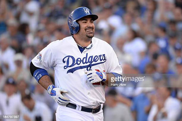 Adrian Gonzalez of the Los Angeles Dodgers reacts after hitting an eighth inning home run against the St Louis Cardinals in Game Five of the National...