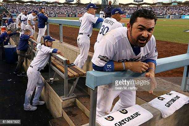 Adrian Gonzalez of the Los Angeles Dodgers reacts in the dugout after being called out on a play at the plate in the second inning against the...