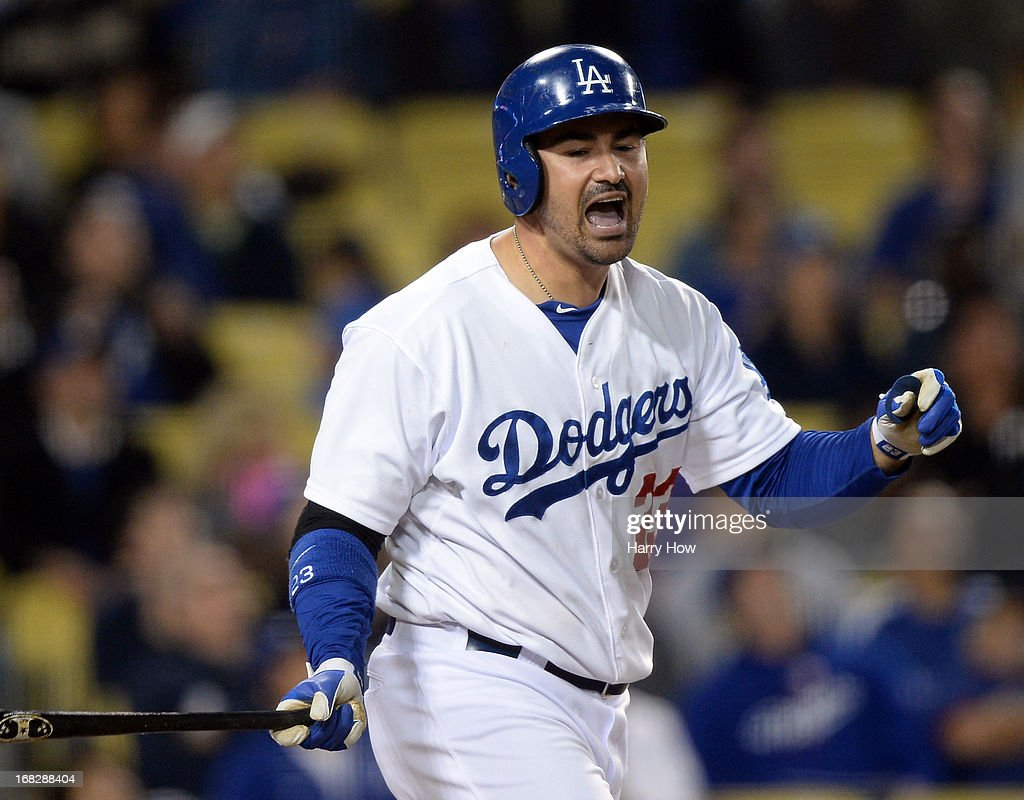 Adrian Gonzalez #23 of the Los Angeles Dodgers reacts to his pop fly for an out during the eighth inning against the Arizona Diamondbacks at Dodger Stadium on May 7, 2013 in Los Angeles, California.