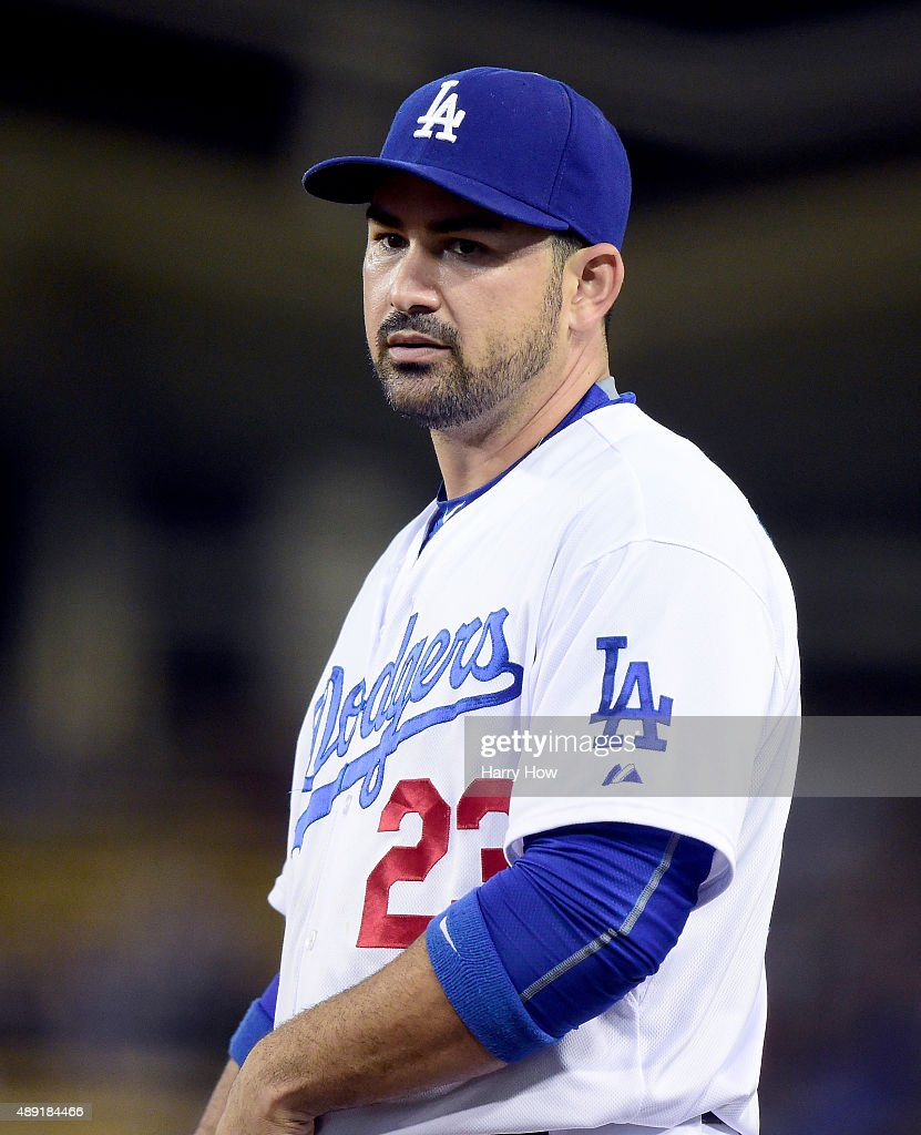 Adrian Gonzalez #23 of the Los Angeles Dodgers reacts to his throwing error during the game against the Colorado Rockies at Dodger Stadium on September 15, 2015 in Los Angeles, California.