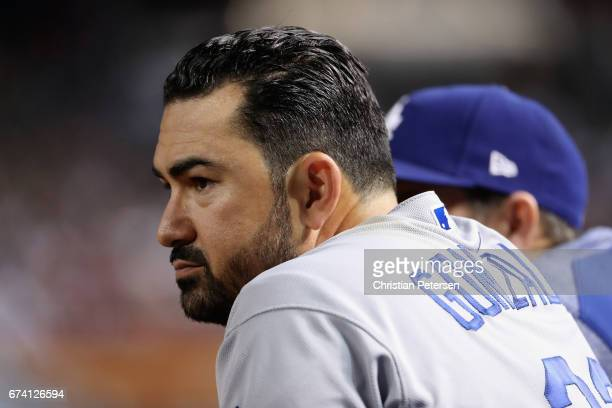 Adrian Gonzalez of the Los Angeles Dodgers watches from the dugout during the MLB game against the Arizona Diamondbacks at Chase Field on April 21...