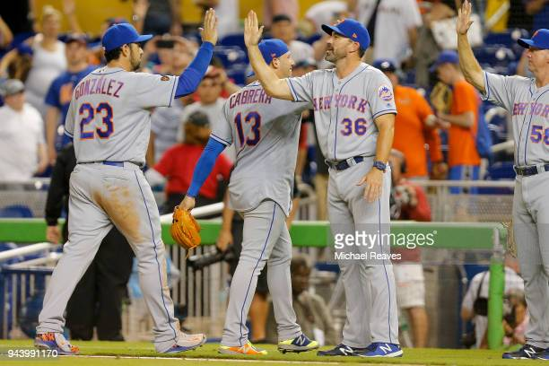 Adrian Gonzalez of the New York Mets celebrates with manager Mickey Callaway after defeating the Miami Marlins 42 at Marlins Park on April 9 2018 in...