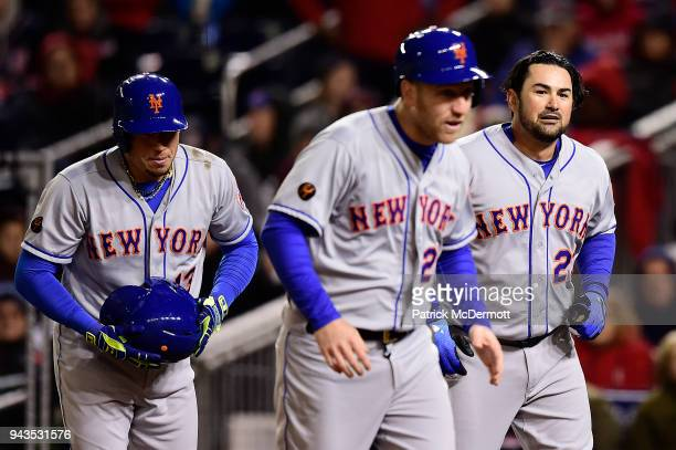 Adrian Gonzalez of the New York Mets celebrates with Todd Frazier and Asdrubal Cabrera after hitting a grand slam in the third inning against the...