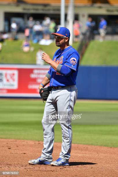 Adrian Gonzalez of the New York Mets fields first base during the spring training game against the Washington Capitals at FITTEAM Ballpark of the...