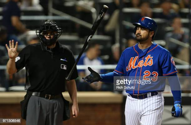 Adrian Gonzalez of the New York Mets flips his bat after striking out against the New York Yankees during the fourth inning of a game at Citi Field...