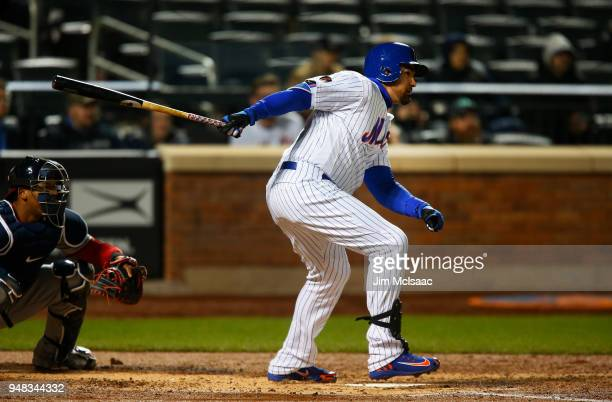 Adrian Gonzalez of the New York Mets follows though on a fourthinning RBI single against the Washington Nationals at Citi Field on April 18 2018 in...