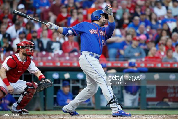 Adrian Gonzalez of the New York Mets hits a solo home run in the third inning against the Cincinnati Reds at Great American Ball Park on May 7 2018...