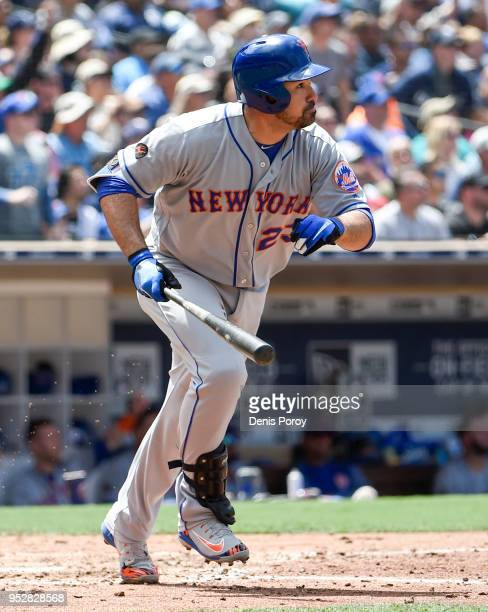 Adrian Gonzalez of the New York Mets hits an RBI double during the first inning of a baseball game against the San Diego Padres at PETCO Park on...