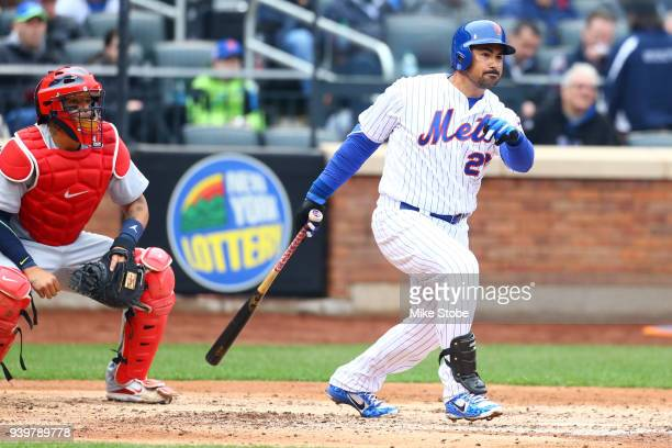 Adrian Gonzalez of the New York Mets hits an RBI single in the fifth inning against the St Louis Cardinals on Opening Day at Citi Field on March 29...