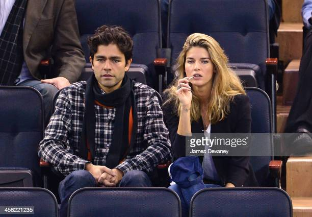 Adrian Grenier and Le Call attend the Long Island Islanders vs New York Rangers game at Madison Square Garden on December 20, 2013 in New York City.
