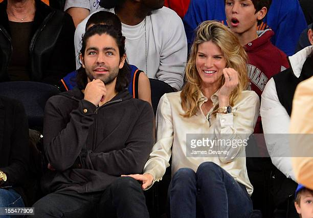 Adrian Grenier and Le Call attend the Philadelphia 76ers vs New York Knicks game at Madison Square Garden on November 4, 2012 in New York City.