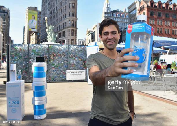 "Adrian Grenier attends the unveiling of SodaStream & Oceanic Society's Anti-Plastic Pollution Installation, ""Drowning Liberty"" in Flatiron Plaza on..."