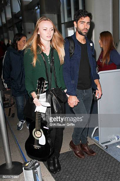 Adrian Grenier is seen at LAX on December 23 2015 in Los Angeles California