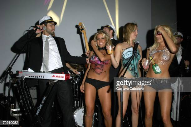 Adrian Grenier onstage with body painted models on New Year's Eve at Hotel Victor on December 31 2006 in Miami Beach Florida