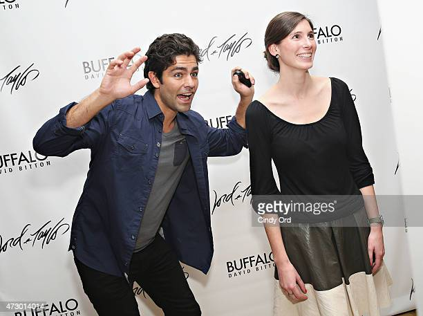 Adrian Grenier photobombs a guest as Lord & Taylor hosts the actor and Buffalo spokesperson on May 11, 2015 in New York City.
