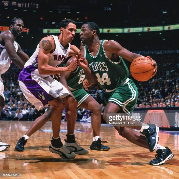 Adrian Griffin drives to the basket against Doug Christie of the Toronto Raptors on November 2 1999 at the Air Canada Centre in Toronto Canada NOTE...