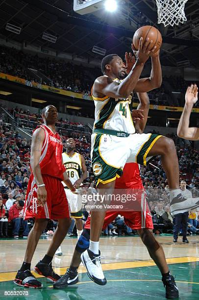 Adrian Griffin of the Seattle SuperSonics goes to the basket past the defense of Tracy McGrady of the Houston Rockets on April 4 2008 at the Key...