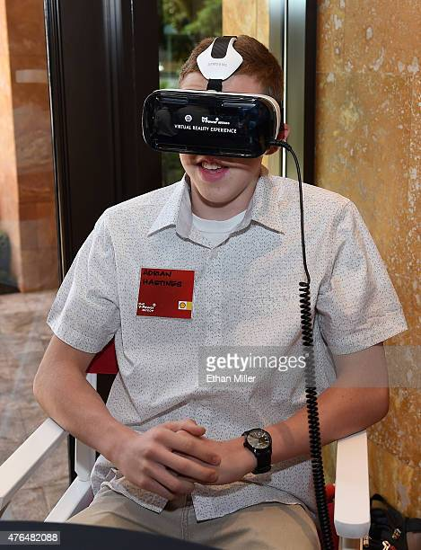 Adrian Hastings takes a 3D engine journey with the Oculus Riftpowered Gear VR headset at the Penske Wynn Ferrari Showroom at Wynn Las Vegas at the...