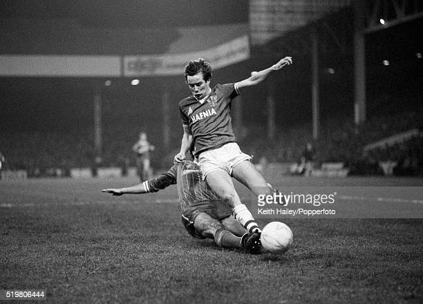 Adrian Heath of Everton is tackled by Mark Lawrenson of Liverpool during the Milk Cup Final replay match at Maine Road in Manchester on the 28th...