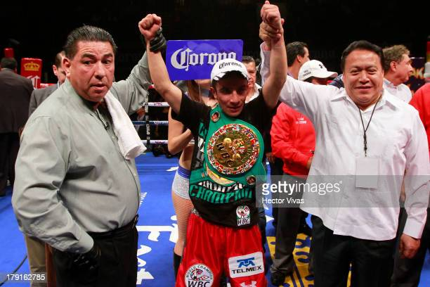 Adrian Hernandez from Mexico celebrates the knock out to Atsushi Kakutani from Japan during their WBC Flyweight World Championship combat at Juan de...