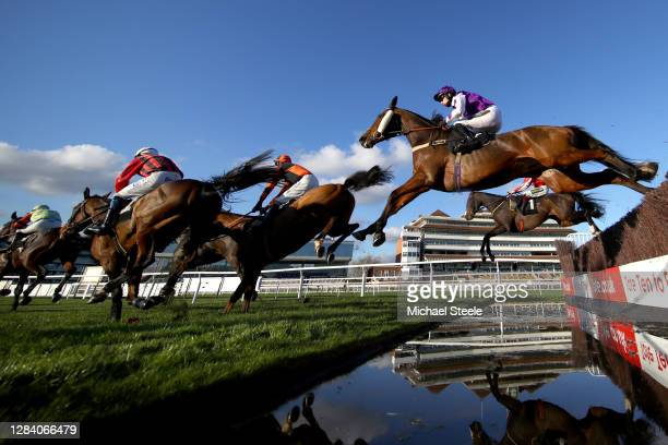 Adrian Heskin riding Azzerti jumps a fence during the Indzine Handicap Chase at Newbury Racecourse on November 05, 2020 in Newbury, England.