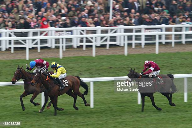 Adrian Heskin riding Milsean on his way to victory from Daniel Mullins riding Milsean and Bryan Cooper riding No More Heroes in the Albert Bartlett...