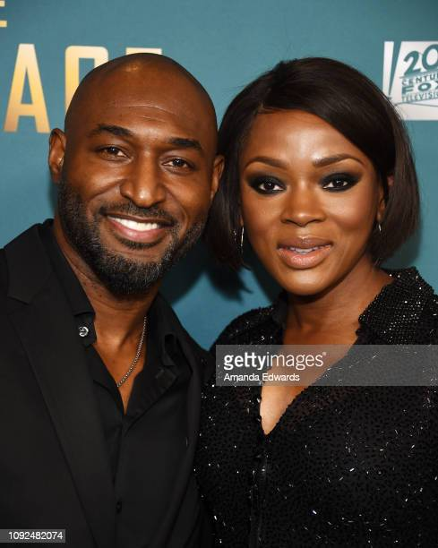 Adrian Holmes and Caroline Chikezie arrive at FOX's 'The Passage' Premiere Party at The Broad Stage on January 10 2019 in Santa Monica California