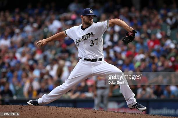 Adrian Houser of the Milwaukee Brewers pitches in the eighth inning against the St Louis Cardinals at Miller Park on June 23 2018 in Milwaukee...
