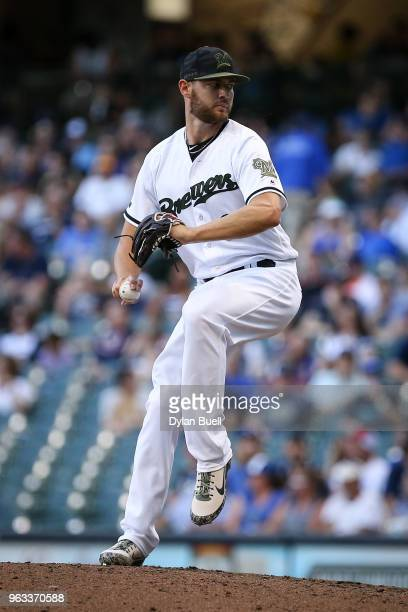 Adrian Houser of the Milwaukee Brewers pitches in the ninth inning against the New York Mets at Miller Park on May 26 2018 in Milwaukee Wisconsin