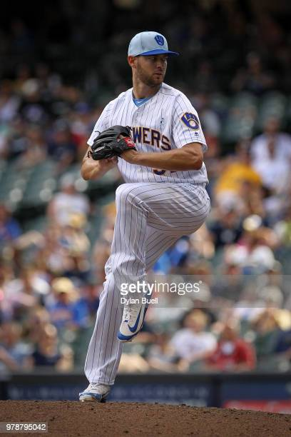Adrian Houser of the Milwaukee Brewers pitches in the ninth inning against the Philadelphia Phillies at Miller Park on June 17 2018 in Milwaukee...