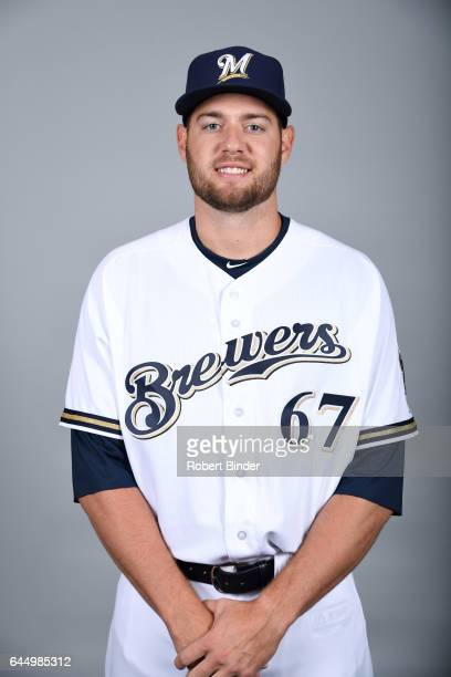 Adrian Houser of the Milwaukee Brewers poses during Photo Day on Wednesday February 22 2017 at Maryvale Baseball Park in Phoenix Arizona
