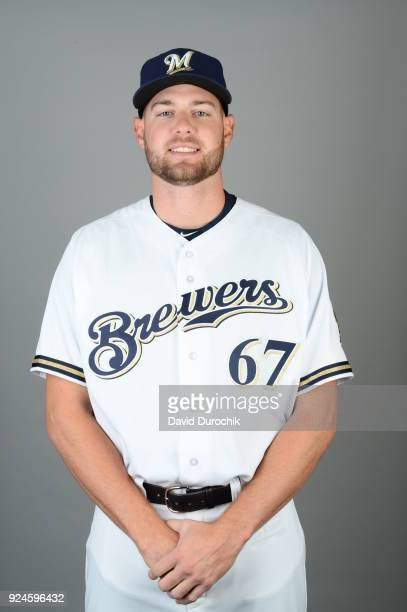 Adrian Houser of the Milwaukee Brewers poses during Photo Day on Thursday February 22 2018 at Maryvale Baseball Park in Phoenix Arizona