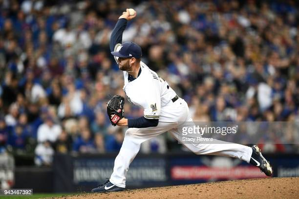 Adrian Houser of the Milwaukee Brewers throws a pitch during the eighth inning of a game against the Chicago Cubs at Miller Park on April 8 2018 in...